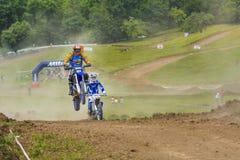 Motorcross racer jumping Stock Images
