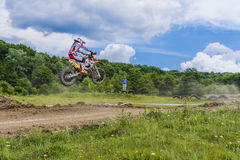 Motorcross racer jumping Royalty Free Stock Images