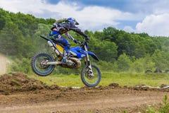 Motorcross racer jumping Royalty Free Stock Image