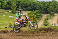 Motorcross racer jumping. Racer on motorcycle during an offroad competition on June 20, 2015 in Bucharest, Romania Royalty Free Stock Photography
