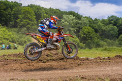 Motorcross racer jumping. Racer on motorcycle during an offroad competition on June 20, 2015 in Bucharest, Romania Stock Images