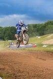 Motorcross racer jumping Stock Image