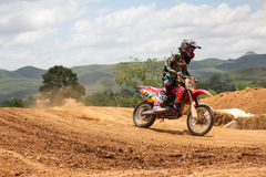 Motorcross racing. MUAKLEK, THAILAND - AUGUST 05: Unidentified riders participate in  competition Supercross Championship of Thailand, on August 05, 2012 in Stock Photo