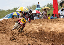 Motorcross racing. MUAKLEK, THAILAND - AUGUST 05: Unidentified rider participates in competition Supercross Championship of Thailand, on August 05, 2012 in Royalty Free Stock Images
