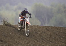 Motorcross rider. Motorcyclist on motorcycle speeding downhill Stock Photo
