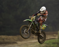 Motorcross rider. Motorcyclist on an off-road motorcycle flying through the air after riding over a jump Stock Photo