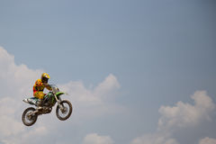 Motorcross riders jump. Yala, Thailand - APRIL 20, 2014: Motorcross riders jump in Yala Motorcross Competition 2014. at Muangmai Track in Yala, Thailand Stock Image