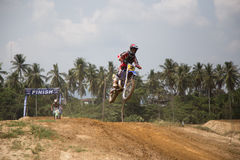 Motorcross riders jump. Yala, Thailand - APRIL 20, 2014: Motorcross riders jump in Yala Motorcross Competition 2014. at Muangmai Track in Yala, Thailand Royalty Free Stock Image