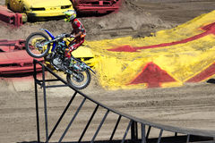 Motorcross stunts. The same motorcross biker moments before his mid-air stunt at the 2013 Monster Jam event Salinas Ca Royalty Free Stock Images
