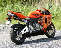 Motorcycle. Picture of orange motorcycle in a parking Royalty Free Stock Photos