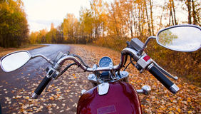 Motorcycle. Close-up of motorcycle on road in autumn Royalty Free Stock Photos
