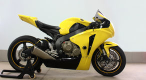 Motorcycle. A yellow sport motorcycle side view isolated royalty free stock images