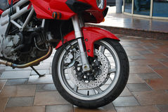 Motorcycle. Beautiful red sport motorcycle wet after the rain Stock Photo