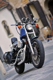 Motorcycle. A generic motorcycle against an urban background Royalty Free Stock Image