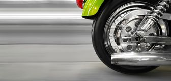 Motorcycle. Part of a luxury motorcycle with blurry asphalt road royalty free stock images