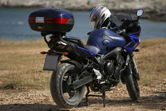 Motorcycle. A generic motorcycle against an country side background Stock Image
