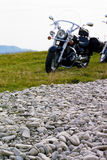 Motorcycle. Behind a road made of stones (focus on the stones Royalty Free Stock Image