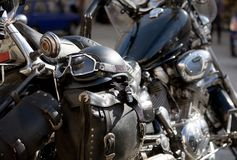 Motorcycle. Parked in sunshine, saddle bags, helmet and goggles Royalty Free Stock Photos