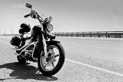 Motorcycle. Black motorcycle on the bridge royalty free stock photography