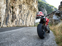Motorcycle. Red motorcycle on a road with rocks Royalty Free Stock Photos