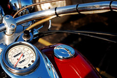 Motorcycle. This is a photo of a Motocycles speedometer, handlebar and Chrome fuel cap Royalty Free Stock Image