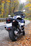 Motorcycle. Big touring blue white motorcycle on the road stopping without rider Royalty Free Stock Image