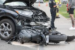 Free Motorcycle Accident, Bike Stuck Under Car Stock Images - 189164044