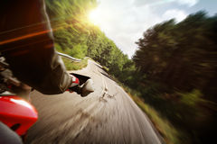 Motorcycle action. Race motorcycle with traveling in forest road Stock Photos