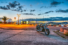 Motorcycle in Alghero harbor Royalty Free Stock Images