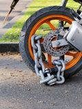 Motorcycle anti-theft chain with padlock security lock on rear w Royalty Free Stock Photos