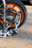 Motorcycle anti-theft chain with padlock security lock on rear w Stock Photography