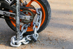 Free Motorcycle Anti-theft Chain With Padlock Security Lock On Rear W Stock Photography - 84849082