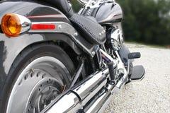 Motorcycle from back. New motorcycle from back on gravel road Stock Photos
