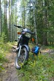 Motorcycle backpack trekking rest forest berries mushrooms picking the sun Royalty Free Stock Image