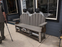 Motorcycle bench in Silverton an old Silver Mining town in the State of Colorado USA. The Narrow Gauge Railway from Durango to Silverton that runs through the Royalty Free Stock Images