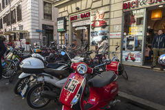 Motorcycle and bicycle rental shop in Rome, Italy Stock Photos