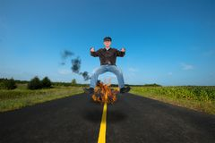 Motorcycle Biker, Motorcyclist, Ride, Rider. Funny Motorcycle biker, motorcyclist rider. A tough guy man is having a ride on the open highway and is burning up stock photography