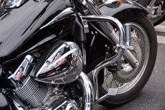 Motorcycle. Black motorcycle side view closeup Stock Image