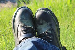 Motorcycle Boots - Biker Relaxing in the Grass royalty free stock photo