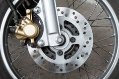 Motorcycle brake disc. Close up of motorcycle brake disc Stock Photo