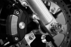 Motorcycle brake disc. Close up of a motorcycle brake disc with brake caliper royalty free stock image