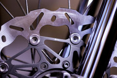 Motorcycle brake disc. Motorcycle front forks and wheel brake rotor, spokes Stock Photo