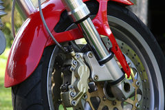 Motorcycle Brakes. Close-up of motorcycle brakes and front wheel stock photography