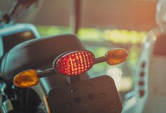 Motorcycle break and turn signal light on blurred background. New big bike park in showroom. Motorbike dealership concept. royalty free stock image