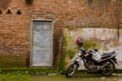Motorcycle and brick wall Royalty Free Stock Photos