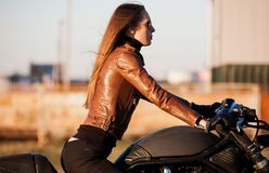 Motorcycle, brown jacket, half height stock photography