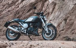 Motorcycle in a cafe racer style. Panoramic shot of a motorcycle in a cafe racer style in the gorge royalty free stock image