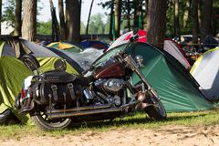 Motorcycle in a camping Royalty Free Stock Photo