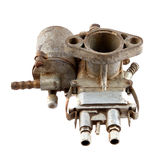Motorcycle carburetor. Dirty old motorcycle carburetor on a white background Stock Photography