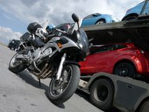 Motorcycle and cars. Yamaha Fazer with autotransporter in the background Royalty Free Stock Images